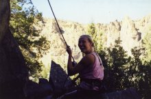 12 Sep 1999 Smith Rock - Georgie belaying at bottom of Meat Grinder